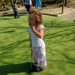 child on golf course.
