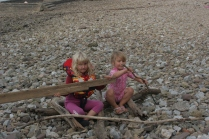 making a rowing boat from driftwood.
