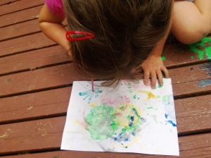 blowing paint with a straw