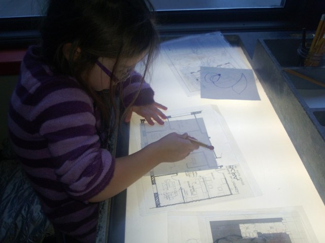 light table with maps and plans