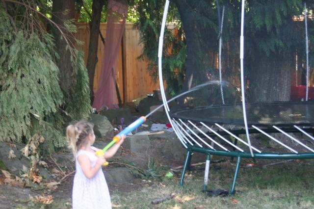 spraying the trampoline