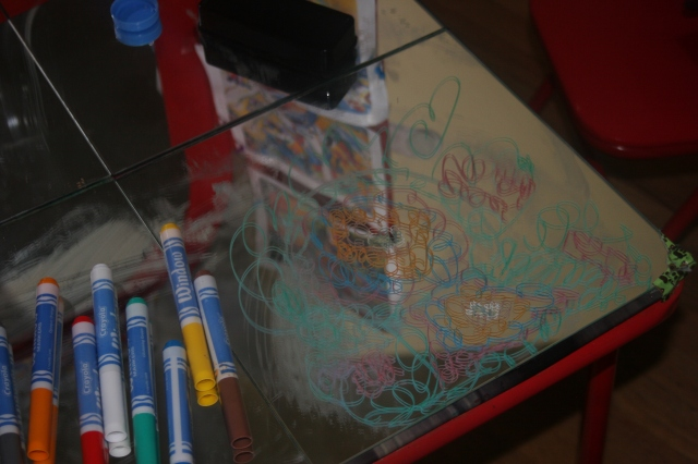 glass pens on a mirror table