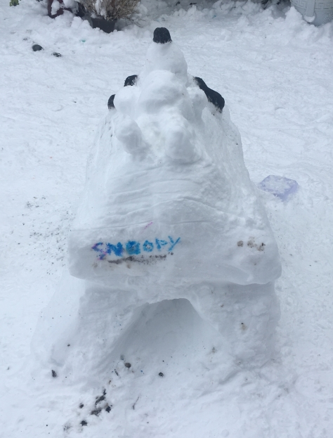 snow sculpture snoopy on kennel