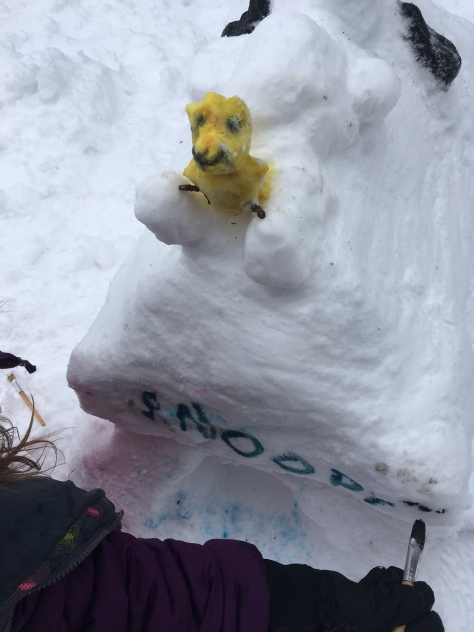woodstock and snoopy snow sculture